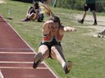 track athlete participating in long jump