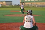 girl pitching softball