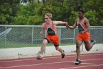 track athletes running relay